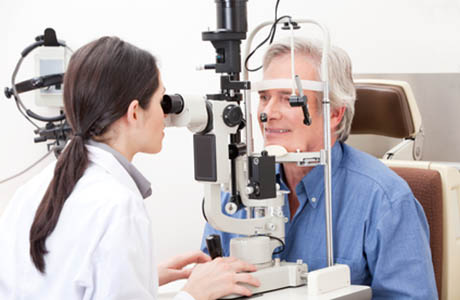 Optometrist doing sight testing that we may soon be able to do at home.